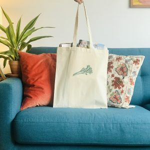 Photo of canvas tote bag with tenderstem broccoli print